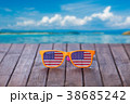 Sunglasses with american flag on wooden table 38685242