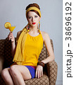 girl in 70s clothes style sitting in armchair 38696192