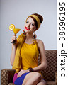 girl in 70s clothes style sitting in armchair 38696195