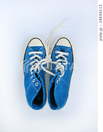 Pair of new blue sneakers isolated on white 38699213