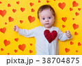 little baby with red heart shape toy 38704875