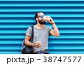 人 コーヒー スマホの写真 38747577
