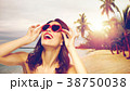 woman with red lipstick and heart shaped shades 38750038
