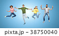 happy people or friends jumping in air over blue 38750040