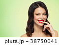 beautiful smiling young woman with red lipstick 38750041