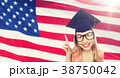 smiling young student woman in mortarboard 38750042