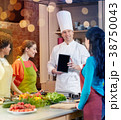 happy women with chef and tablet pc in kitchen 38750043
