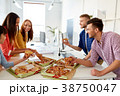 happy business team eating pizza at office 38750047