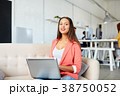 happy woman with laptop working at office 38750052