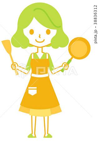 フライパンと木ベラを持つ女性 38836312