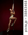 beautiful pole dancer in golden bodywear on pylon 38843468