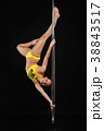 beautiful pole dancer in yellow costume on pylon 38843517