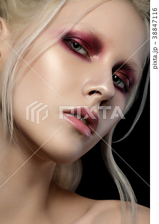 Portrait of young woman with fashion make up 38847116