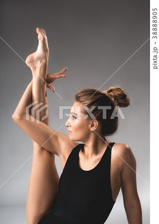 Tranquil woman warming up the muscles 38888905