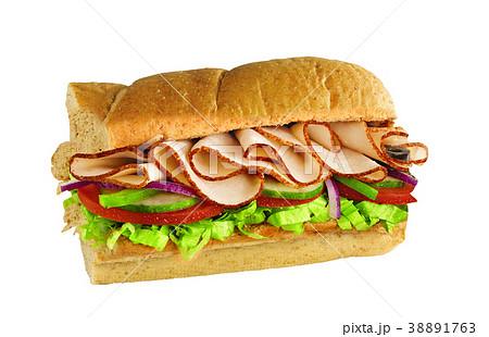 half of long tasty subway baguette sandwich 38891763
