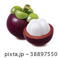 Whole mangosteen and piece cut in half isolated 38897550