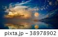 Full moon rising above serene sea in sunset sky 38978902