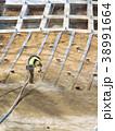 法面保護と緑化のために長繊維をまぜて植生基材吹付をします 38991664