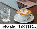 Hot art latte coffee cup on wooden table 39016321