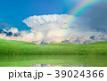 Colorful rainbow above green hills 39024366