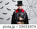 Vampire Halloween Concept - Portrait of handsome 39033974
