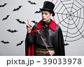 Vampire Halloween Concept - Portrait of handsome 39033978