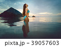 Woman on ocean beach in tropical vacation 39057603