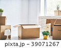 Cardboard boxes in room 39071267