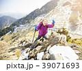 happy senior woman hiking on the mountain 39071693