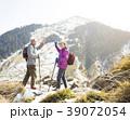 happy senior couple hiking on the mountain. 39072054