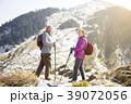 happy senior couple hiking on the mountain. 39072056