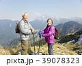 happy senior couple hiking on the mountain 39078323