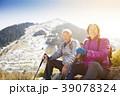 happy senior couple hiking on the mountain 39078324