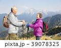happy senior couple hiking on the mountain 39078325
