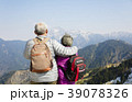 rear view of senior couple watching the mountains 39078326