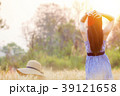 Woman spending summer holiday in barley field 39121658