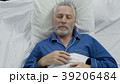 Old man enjoying sleeping comfort due to 39206484