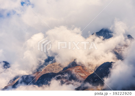 Mountains in clouds in overcast evening in Nepal 39222920