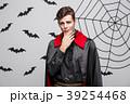 Vampire Halloween Concept - Portrait of handsome 39254468