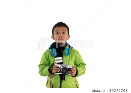 Cute little boy with camera on white background. 39275763