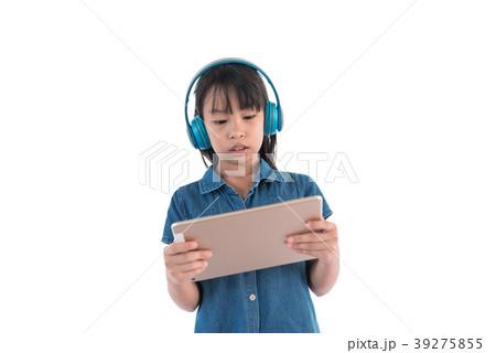 girl wearing headphones using modern tablet 39275855