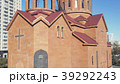 Christian temple made of red bricks with city 39292243