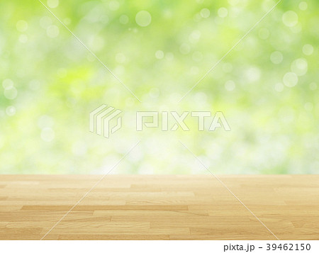 wood table top on green bokeh abstract background 39462150