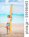 Little adorable girl playing beach volleyball with 39598465
