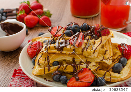Belgian waffles with blueberries, strawberries 39628547