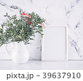 Blank frame and pink flowers over marble table 39637910