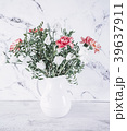 Pink and White flowers on vase over marble table 39637911