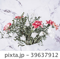 Pink and White flowers on vase over marble table 39637912