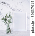 Blank frame and white flowers over marble table 39637915