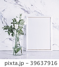 Blank frame and white flowers over marble table 39637916